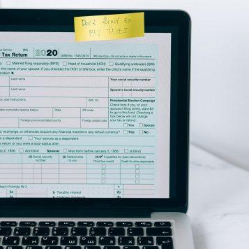Laptop displaying tax forms