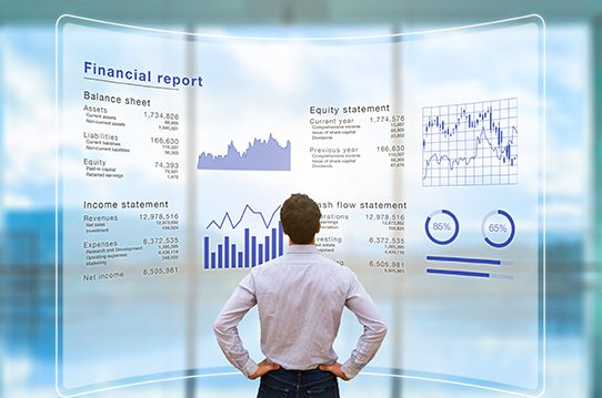 Man stands in front of projected financial report
